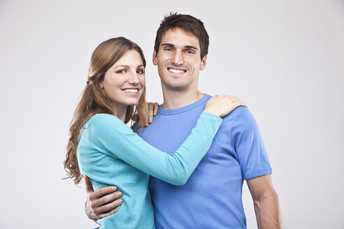 Man embracing woman, smiling, portrait - SSF00029