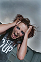 Woman pulling her hair and looking angry. - NHF01222