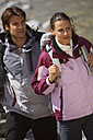 Germany, Bavaria, Couple trekking, looking away - KEF00012