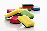 Multi coloured kitchen sponges against white background - 12183CS-U