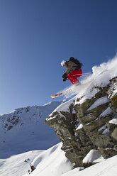 Austria, Tyrol, Kitzbuehel, Woman skiing on mountain - FFF01115