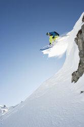Austria, Man jumping on arlberg mountain - MIRF00060
