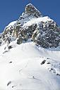 Austria, Man skiing on arlberg mountain - MIRF00057