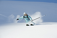 Austria, Woman skiing on arlberg mountain, smiling - MIRF00051