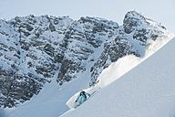 Austria, Woman skiing on arlberg mountain - MIRF00048