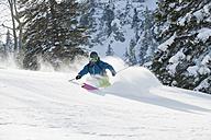 Germany, Man skiing on herzogstand mountain - MIRF00042