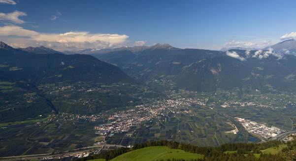 Italy, South Tyrol, Meran, Elevated view of city with mountains in background - SMF00619