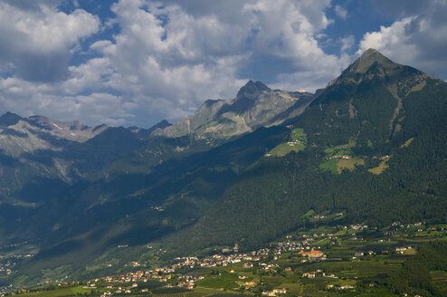 Italy, South Tyrol, Meran, Elevated view of city with mountains in background - SMF00616