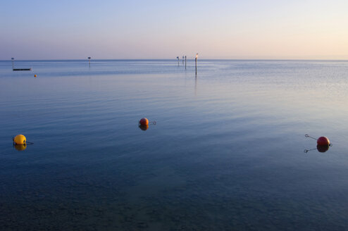 Germany, Immenstaad, Lake Constance, Buoy in lake at dusk - SMF00583