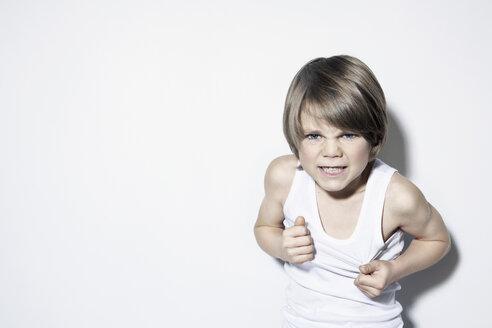 Boy (8-9) clenching teeth, close-up, portrait - PDF00011