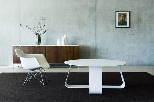 Switzerland, Wintertur, Designer chair and designer table in living room - HOEF00267