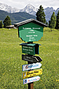 Germany, Bavaria, Sign board in hump-meadow with karwendel mountains in background - 12765CS-U