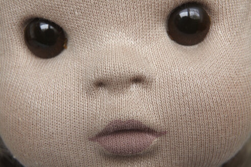 Close-up of doll face made of knitted fabric - TL00455