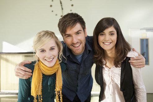 Germany, Leipzig, University students enjoying together, smiling, portrait - BABF00597