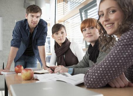 Germany, Leipzig, University students studying together, smiling, portrait - BABF00543