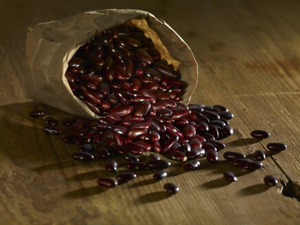 Kidney beans spilled on wooden surface - SRSF00145