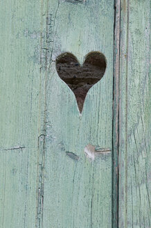 France, Alsace, Heart shaped hole on weathered wooden door - AWDF00557