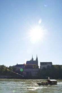 Switzerland, Basel, Rhytaxi on Rhine river, Basel Cathedral in background - LFF000183