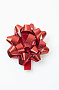 Red ribbon bow on white background - MAEF002406