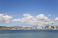 New Zealand, Auckland, North Island, View of city skyline with harbour terminals - GWF001180