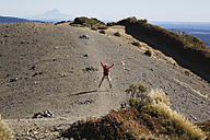 New Zealand, North Island, Woman jumping on volcanic moraine - GWF001234