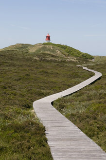 Germany, Northsea, Amrum, View of light house cross light in dune - AWDF000591