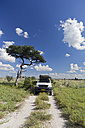 Africa, Botswana, Land vehicle passing through central kalahari game reserve - FOF002222