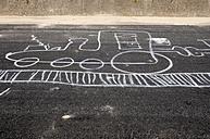 Germany, Northsea, Amrum, chalk drawing of locomotive on tarmac - AWDF000654