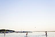 Germany, Mecklenburg-Western Pomerania, Boys playing in Fleesensee lake - MSF002406