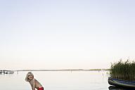 Germany, Mecklenburg-Western Pomerania, Boy playing in fleesensee lake - MSF002397