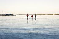 Germany, Western Pomerania, Boys walking in fleesensee lake - MSF002394
