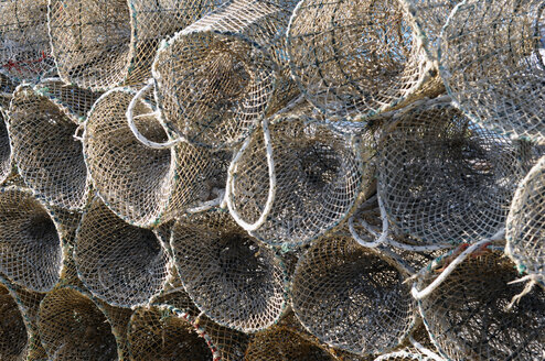 Italy, Sardinia, Cagliari, Stack of fishing nets cages - LRF000524