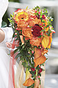 Bride holding wedding rose bouquet - WWF001502