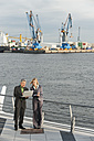Germany, Hamburg, Business people working at harbour - WESTF015278