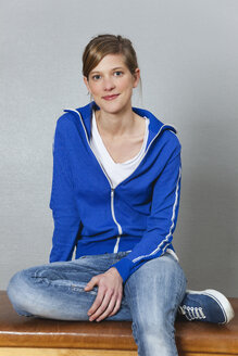 Germany, Berlin, Young woman smiling, portrait - BAEF000083