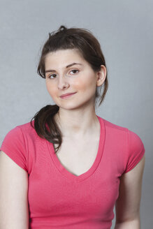 Germany, Berlin, Young woman smiling, close up, portrait - BAEF000146