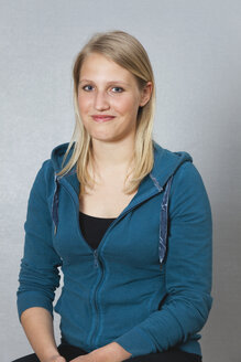 Germany, Berlin, Young woman smiling, close up, portrait - BAEF000161