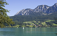 Austria, Salzkammergut, View of steinbach am attersee and attersee lake with hoellen mountains in background - WW001581