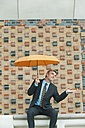 Germany, Hamburg, Businessman with umbrella - WESTF015379