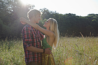 Germany, Dortmund, Young couple smiling - SKF000249