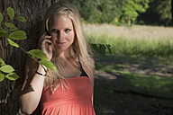 Germany, Dortmund, Young woman on the phone - SKF000261