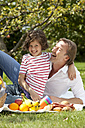 Germany, Bavaria, Father and daughter (8-9 Years) having fun at picnic, smiling - MAEF002573