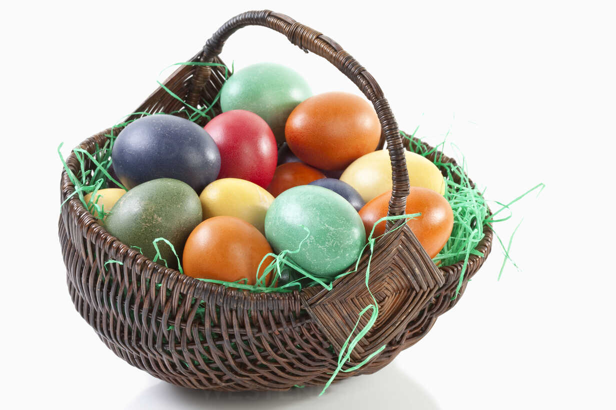 variety-of-easter-eggs-in-basket-on-whit