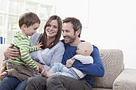 Germany, Bavaria, Munich, Family having fun in living room, smiling - RBF000347