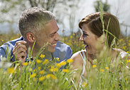 Germany, Munich, Mature couple in garden, smiling - WBF000019