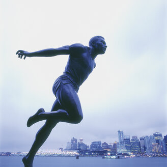 Canada, British Colombia, Vancouver, Stanley Park, Statue of harry jerome with city in background - WBF000212