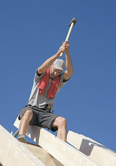 Germany, Mature man working on roof - WBF000646