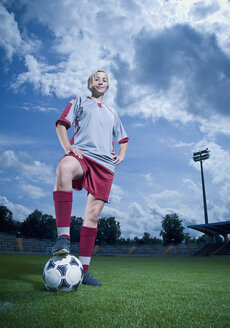 Germany, Augsburg, Football player standing in football ground, portrait - WBF000787