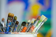 Close up of dirty paint brushes - HKF000297