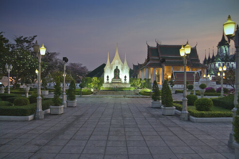 Thailand, Bangkok, View of temple with illuminated street lights - HKF000374